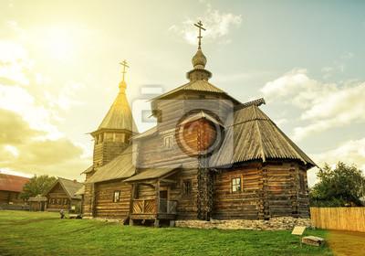 Постер Суздаль Традиционная русская деревянная церковь в СуздалеСуздаль<br>Постер на холсте или бумаге. Любого нужного вам размера. В раме или без. Подвес в комплекте. Трехслойная надежная упаковка. Доставим в любую точку России. Вам осталось только повесить картину на стену!<br>