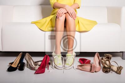 Постер Оформление офиса Женщина сидит на диване и пытается на обувь, 30x20 см, на бумагеОбувной магазин<br>Постер на холсте или бумаге. Любого нужного вам размера. В раме или без. Подвес в комплекте. Трехслойная надежная упаковка. Доставим в любую точку России. Вам осталось только повесить картину на стену!<br>