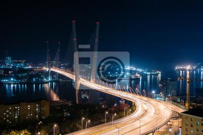 Постер Владивосток Золотой мост во Владивостоке ночьюВладивосток<br>Постер на холсте или бумаге. Любого нужного вам размера. В раме или без. Подвес в комплекте. Трехслойная надежная упаковка. Доставим в любую точку России. Вам осталось только повесить картину на стену!<br>