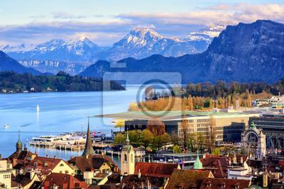 Постер Швейцария Люцерн город на озеро Люцерн и Альпы горыШвейцария<br>Постер на холсте или бумаге. Любого нужного вам размера. В раме или без. Подвес в комплекте. Трехслойная надежная упаковка. Доставим в любую точку России. Вам осталось только повесить картину на стену!<br>