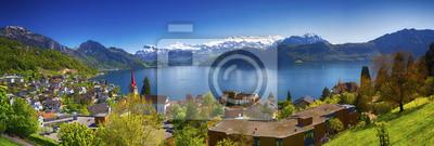 Постер Швейцария Изображения панорама городка Веггис, на берегу озера Люцерн (Vierwaldstatersee), гора Пилатус и швейцарских Альп на фоне, рядом с такими известными Люцерна (Люцерн) город, ШвейцарияШвейцария<br>Постер на холсте или бумаге. Любого нужного вам размера. В раме или без. Подвес в комплекте. Трехслойная надежная упаковка. Доставим в любую точку России. Вам осталось только повесить картину на стену!<br>