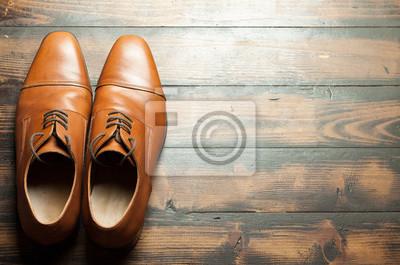 Постер Оформление офиса Мужские кожаные ботинки на деревянном полу, 30x20 см, на бумагеОбувной магазин<br>Постер на холсте или бумаге. Любого нужного вам размера. В раме или без. Подвес в комплекте. Трехслойная надежная упаковка. Доставим в любую точку России. Вам осталось только повесить картину на стену!<br>