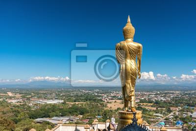 Постер Таиланд Золотая статуя Будды в храме Као Ной, провинции Нан, ТаиландТаиланд<br>Постер на холсте или бумаге. Любого нужного вам размера. В раме или без. Подвес в комплекте. Трехслойная надежная упаковка. Доставим в любую точку России. Вам осталось только повесить картину на стену!<br>