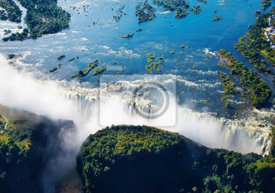 Постер Африканский пейзаж Реки Замбези и Водопада Виктория, вид с воздухаАфриканский пейзаж<br>Постер на холсте или бумаге. Любого нужного вам размера. В раме или без. Подвес в комплекте. Трехслойная надежная упаковка. Доставим в любую точку России. Вам осталось только повесить картину на стену!<br>