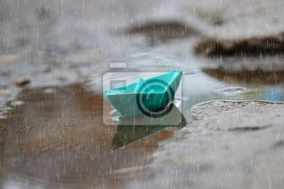 Постер Дождь Синяя лодка, дождь и лужи. дождливый деньДождь<br>Постер на холсте или бумаге. Любого нужного вам размера. В раме или без. Подвес в комплекте. Трехслойная надежная упаковка. Доставим в любую точку России. Вам осталось только повесить картину на стену!<br>