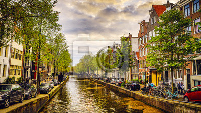 Самые знаменитые каналы и Набережные города Амстердам во время заката. Общий вид городского пейзажа и архитектуры Нидерландов., 36x20 см, на бумагеАмстердам<br>Постер на холсте или бумаге. Любого нужного вам размера. В раме или без. Подвес в комплекте. Трехслойная надежная упаковка. Доставим в любую точку России. Вам осталось только повесить картину на стену!<br>