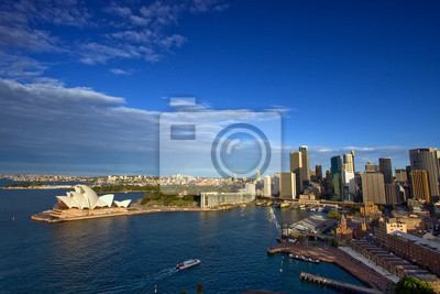 Постер Сидней Город на Circular Quay, Сидней, АвстралияСидней<br>Постер на холсте или бумаге. Любого нужного вам размера. В раме или без. Подвес в комплекте. Трехслойная надежная упаковка. Доставим в любую точку России. Вам осталось только повесить картину на стену!<br>