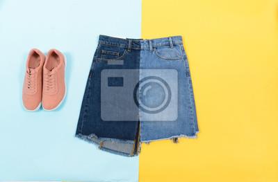 Синяя джинсовая юбка ,туфли, изолированные на синем и желтом фоне, 30x20 см, на бумагеШоппинг<br>Постер на холсте или бумаге. Любого нужного вам размера. В раме или без. Подвес в комплекте. Трехслойная надежная упаковка. Доставим в любую точку России. Вам осталось только повесить картину на стену!<br>