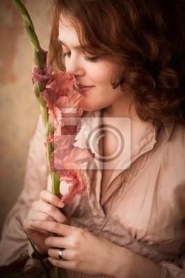Постер Гладиолусы Молодая женщина запахи цветовГладиолусы<br>Постер на холсте или бумаге. Любого нужного вам размера. В раме или без. Подвес в комплекте. Трехслойная надежная упаковка. Доставим в любую точку России. Вам осталось только повесить картину на стену!<br>