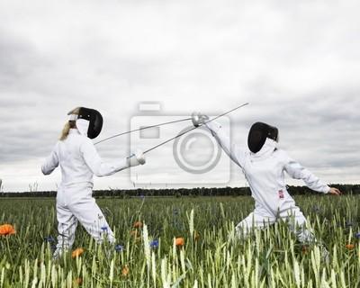 Постер Фехтование Две девушки фехтование в поле.Фехтование<br>Постер на холсте или бумаге. Любого нужного вам размера. В раме или без. Подвес в комплекте. Трехслойная надежная упаковка. Доставим в любую точку России. Вам осталось только повесить картину на стену!<br>