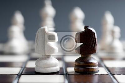 Постер Шахматы Два деревянных шахматных конейШахматы<br>Постер на холсте или бумаге. Любого нужного вам размера. В раме или без. Подвес в комплекте. Трехслойная надежная упаковка. Доставим в любую точку России. Вам осталось только повесить картину на стену!<br>