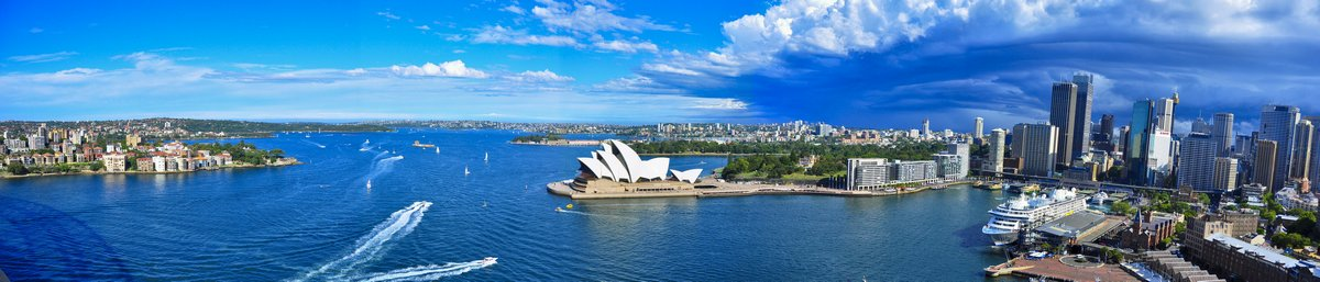 Постер Сидней Панорама гавани Сиднея. Сидней, АвстралияСидней<br>Постер на холсте или бумаге. Любого нужного вам размера. В раме или без. Подвес в комплекте. Трехслойная надежная упаковка. Доставим в любую точку России. Вам осталось только повесить картину на стену!<br>