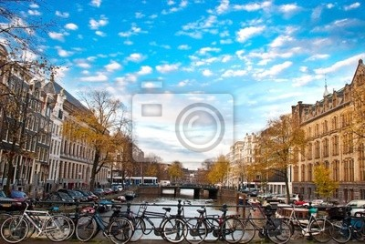 Постер Амстердам Велосипед в АмстердамеАмстердам<br>Постер на холсте или бумаге. Любого нужного вам размера. В раме или без. Подвес в комплекте. Трехслойная надежная упаковка. Доставим в любую точку России. Вам осталось только повесить картину на стену!<br>