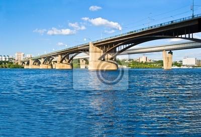 Постер Новосибирск Мост через реку Обь в НовосибирскеНовосибирск<br>Постер на холсте или бумаге. Любого нужного вам размера. В раме или без. Подвес в комплекте. Трехслойная надежная упаковка. Доставим в любую точку России. Вам осталось только повесить картину на стену!<br>