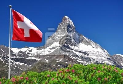 Постер Альпийский пейзаж Красивая гора Маттерхорн со швейцарского флага - швейцарских АльпахАльпийский пейзаж<br>Постер на холсте или бумаге. Любого нужного вам размера. В раме или без. Подвес в комплекте. Трехслойная надежная упаковка. Доставим в любую точку России. Вам осталось только повесить картину на стену!<br>