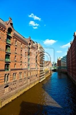 Постер Гамбург Speicherstadt в ГамбургеГамбург<br>Постер на холсте или бумаге. Любого нужного вам размера. В раме или без. Подвес в комплекте. Трехслойная надежная упаковка. Доставим в любую точку России. Вам осталось только повесить картину на стену!<br>