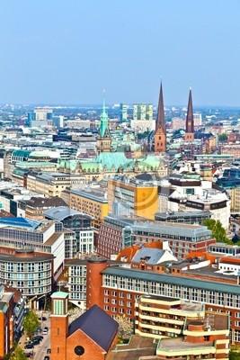 Постер Гамбург Облик города Гамбурга от знаменитой башни МихаэлисГамбург<br>Постер на холсте или бумаге. Любого нужного вам размера. В раме или без. Подвес в комплекте. Трехслойная надежная упаковка. Доставим в любую точку России. Вам осталось только повесить картину на стену!<br>
