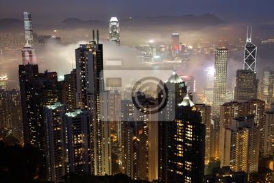 Постер Гонконг Гонконг на туманный вечер. Вид с вершиныГонконг<br>Постер на холсте или бумаге. Любого нужного вам размера. В раме или без. Подвес в комплекте. Трехслойная надежная упаковка. Доставим в любую точку России. Вам осталось только повесить картину на стену!<br>