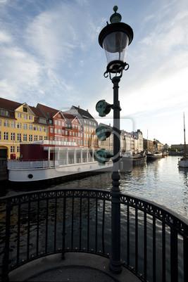 Постер Копенгаген Копенгаген NyhavnКопенгаген<br>Постер на холсте или бумаге. Любого нужного вам размера. В раме или без. Подвес в комплекте. Трехслойная надежная упаковка. Доставим в любую точку России. Вам осталось только повесить картину на стену!<br>