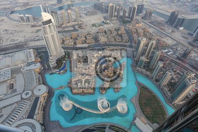 Постер Дубай Дубайский Фонтан как видно из Burj KhalifaДубай<br>Постер на холсте или бумаге. Любого нужного вам размера. В раме или без. Подвес в комплекте. Трехслойная надежная упаковка. Доставим в любую точку России. Вам осталось только повесить картину на стену!<br>