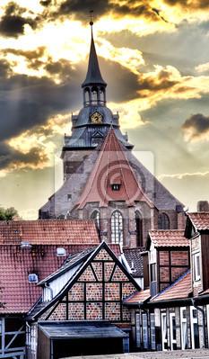 Постер Гамбург Святого Михаила, Церковь, Lueneburg, ГерманияГамбург<br>Постер на холсте или бумаге. Любого нужного вам размера. В раме или без. Подвес в комплекте. Трехслойная надежная упаковка. Доставим в любую точку России. Вам осталось только повесить картину на стену!<br>