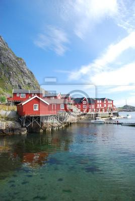 Постер Норвегия Типичный rorbu села на Лофотенских островах в НорвегииНорвегия<br>Постер на холсте или бумаге. Любого нужного вам размера. В раме или без. Подвес в комплекте. Трехслойная надежная упаковка. Доставим в любую точку России. Вам осталось только повесить картину на стену!<br>