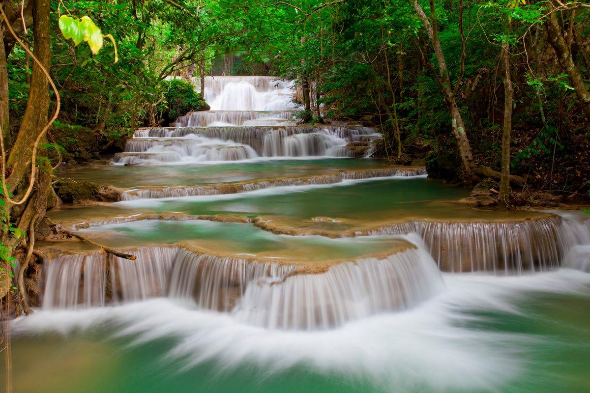 Постер Водопады Deep forest Водопад в ТаиландеВодопады<br>Постер на холсте или бумаге. Любого нужного вам размера. В раме или без. Подвес в комплекте. Трехслойная надежная упаковка. Доставим в любую точку России. Вам осталось только повесить картину на стену!<br>