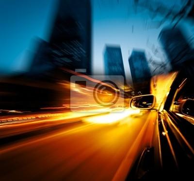 Постер Шанхай Ускорение автомобиля через городШанхай<br>Постер на холсте или бумаге. Любого нужного вам размера. В раме или без. Подвес в комплекте. Трехслойная надежная упаковка. Доставим в любую точку России. Вам осталось только повесить картину на стену!<br>
