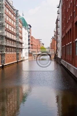 Постер Гамбург SpeicherstadtГамбург<br>Постер на холсте или бумаге. Любого нужного вам размера. В раме или без. Подвес в комплекте. Трехслойная надежная упаковка. Доставим в любую точку России. Вам осталось только повесить картину на стену!<br>