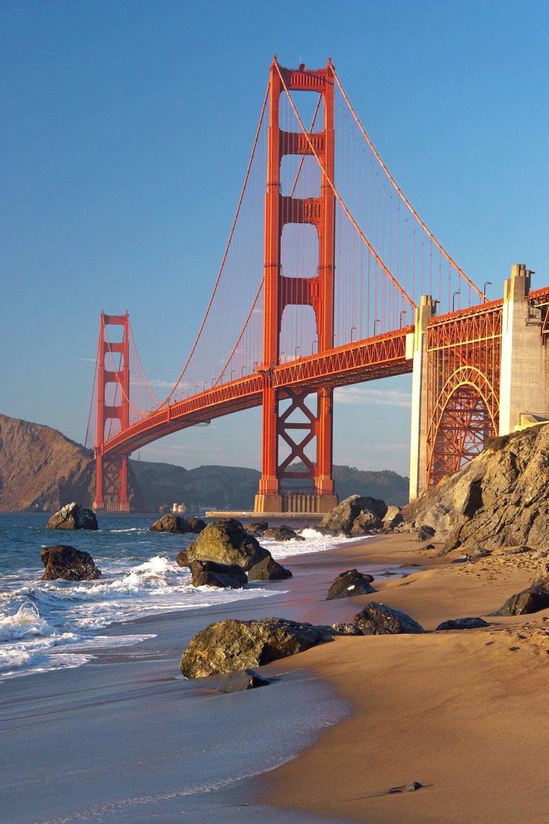 Постер Сан-Франциско Мост золотые Ворота в Сан-Франциско во время закатаСан-Франциско<br>Постер на холсте или бумаге. Любого нужного вам размера. В раме или без. Подвес в комплекте. Трехслойная надежная упаковка. Доставим в любую точку России. Вам осталось только повесить картину на стену!<br>