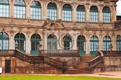 Постер Дрезден Цвингер-дворец в ДрезденеДрезден<br>Постер на холсте или бумаге. Любого нужного вам размера. В раме или без. Подвес в комплекте. Трехслойная надежная упаковка. Доставим в любую точку России. Вам осталось только повесить картину на стену!<br>