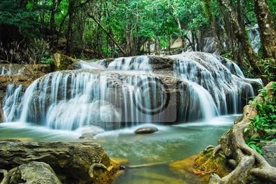 Постер Водопады Deep forest Водопад в Канчанабури, ТаиландВодопады<br>Постер на холсте или бумаге. Любого нужного вам размера. В раме или без. Подвес в комплекте. Трехслойная надежная упаковка. Доставим в любую точку России. Вам осталось только повесить картину на стену!<br>