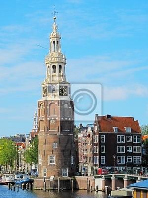 Постер Амстердам Башня МонталбанАмстердам<br>Постер на холсте или бумаге. Любого нужного вам размера. В раме или без. Подвес в комплекте. Трехслойная надежная упаковка. Доставим в любую точку России. Вам осталось только повесить картину на стену!<br>