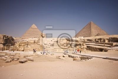 Постер Архитектура Постер 37544400-771, 30x20 см, на бумагеЕгипетские пирамиды<br>Постер на холсте или бумаге. Любого нужного вам размера. В раме или без. Подвес в комплекте. Трехслойная надежная упаковка. Доставим в любую точку России. Вам осталось только повесить картину на стену!<br>