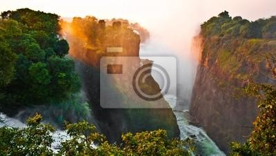 Постер Африканский пейзаж Водопад Виктория на границе Зимбабве и ЗамбииАфриканский пейзаж<br>Постер на холсте или бумаге. Любого нужного вам размера. В раме или без. Подвес в комплекте. Трехслойная надежная упаковка. Доставим в любую точку России. Вам осталось только повесить картину на стену!<br>