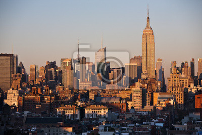 Постер Нью-Йорк Skyline фон, Манхэттен, Нью-Йорк im SonnenuntergangНью-Йорк<br>Постер на холсте или бумаге. Любого нужного вам размера. В раме или без. Подвес в комплекте. Трехслойная надежная упаковка. Доставим в любую точку России. Вам осталось только повесить картину на стену!<br>