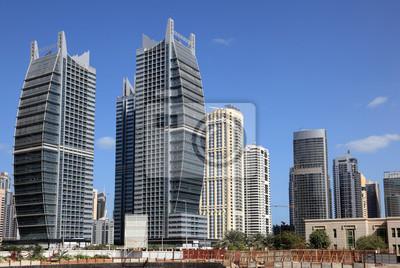 Постер Дубай Jumeirah Lakes Towers в Дубае, Объединенные Арабские ЭмиратыДубай<br>Постер на холсте или бумаге. Любого нужного вам размера. В раме или без. Подвес в комплекте. Трехслойная надежная упаковка. Доставим в любую точку России. Вам осталось только повесить картину на стену!<br>