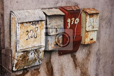 Постер Россия Российские почтовые ящики на оштукатуренную стенуРоссия<br>Постер на холсте или бумаге. Любого нужного вам размера. В раме или без. Подвес в комплекте. Трехслойная надежная упаковка. Доставим в любую точку России. Вам осталось только повесить картину на стену!<br>