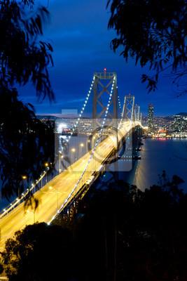 Постер Сан-Франциско Bay Bridge после закатаСан-Франциско<br>Постер на холсте или бумаге. Любого нужного вам размера. В раме или без. Подвес в комплекте. Трехслойная надежная упаковка. Доставим в любую точку России. Вам осталось только повесить картину на стену!<br>