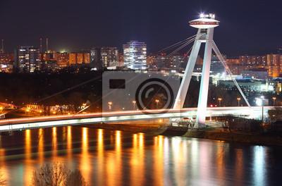 Постер Словакия Новый мост в Братислава - СловакияСловакия<br>Постер на холсте или бумаге. Любого нужного вам размера. В раме или без. Подвес в комплекте. Трехслойная надежная упаковка. Доставим в любую точку России. Вам осталось только повесить картину на стену!<br>