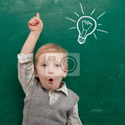 Постер Образование Веселый улыбчивый ребенок на доске.Образование<br>Постер на холсте или бумаге. Любого нужного вам размера. В раме или без. Подвес в комплекте. Трехслойная надежная упаковка. Доставим в любую точку России. Вам осталось только повесить картину на стену!<br>