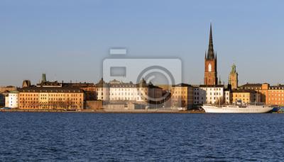 Постер Стокгольм Панорама острова Риддархольмен в Стокгольме, Швеция.Стокгольм<br>Постер на холсте или бумаге. Любого нужного вам размера. В раме или без. Подвес в комплекте. Трехслойная надежная упаковка. Доставим в любую точку России. Вам осталось только повесить картину на стену!<br>