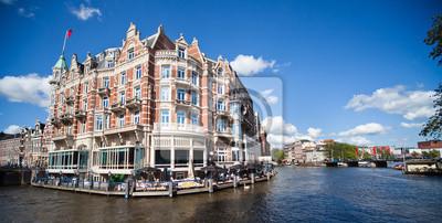 Постер Амстердам Это АмстердамАмстердам<br>Постер на холсте или бумаге. Любого нужного вам размера. В раме или без. Подвес в комплекте. Трехслойная надежная упаковка. Доставим в любую точку России. Вам осталось только повесить картину на стену!<br>