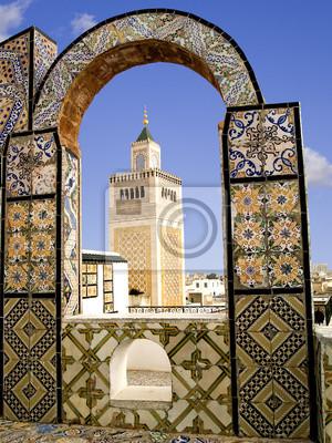 Постер Тунис Мечеть, минарет, обрамленные плиткой АРКА в города Тунис, ТунисТунис<br>Постер на холсте или бумаге. Любого нужного вам размера. В раме или без. Подвес в комплекте. Трехслойная надежная упаковка. Доставим в любую точку России. Вам осталось только повесить картину на стену!<br>