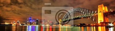 Постер Сидней Sydney Opera House и МостСидней<br>Постер на холсте или бумаге. Любого нужного вам размера. В раме или без. Подвес в комплекте. Трехслойная надежная упаковка. Доставим в любую точку России. Вам осталось только повесить картину на стену!<br>