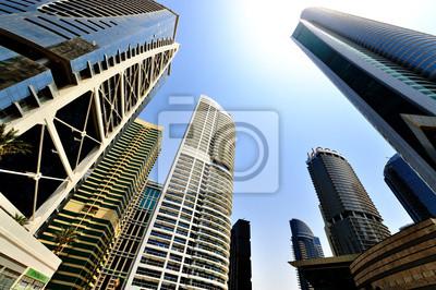 Постер Дубай Дубай. Jumeirah Lake TowersДубай<br>Постер на холсте или бумаге. Любого нужного вам размера. В раме или без. Подвес в комплекте. Трехслойная надежная упаковка. Доставим в любую точку России. Вам осталось только повесить картину на стену!<br>