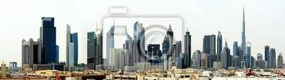 Постер ОАЭ Дубай. Всемирный Торговый центр и Burj KhalifaОАЭ<br>Постер на холсте или бумаге. Любого нужного вам размера. В раме или без. Подвес в комплекте. Трехслойная надежная упаковка. Доставим в любую точку России. Вам осталось только повесить картину на стену!<br>