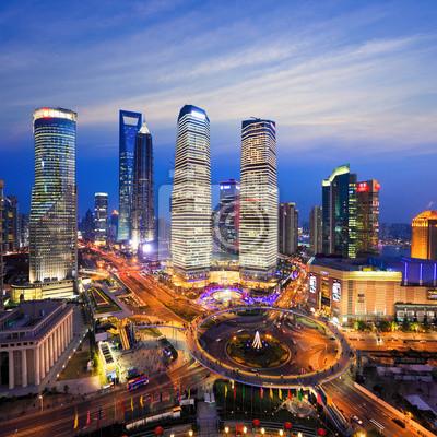 Постер Шанхай Вид с воздуха Шанхая skyline ночьюШанхай<br>Постер на холсте или бумаге. Любого нужного вам размера. В раме или без. Подвес в комплекте. Трехслойная надежная упаковка. Доставим в любую точку России. Вам осталось только повесить картину на стену!<br>