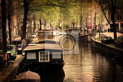 Постер Нидерланды Амстердам. Романтический канал, катера, лодки.Нидерланды<br>Постер на холсте или бумаге. Любого нужного вам размера. В раме или без. Подвес в комплекте. Трехслойная надежная упаковка. Доставим в любую точку России. Вам осталось только повесить картину на стену!<br>