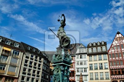 Постер Франкфурт Статуя и колоритное здание во ФранкфуртеФранкфурт<br>Постер на холсте или бумаге. Любого нужного вам размера. В раме или без. Подвес в комплекте. Трехслойная надежная упаковка. Доставим в любую точку России. Вам осталось только повесить картину на стену!<br>